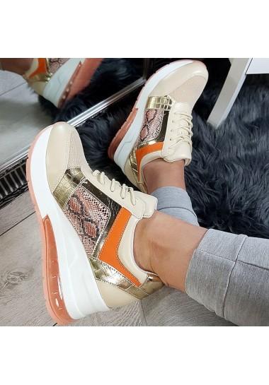 Złote sneakersy na koturnie...